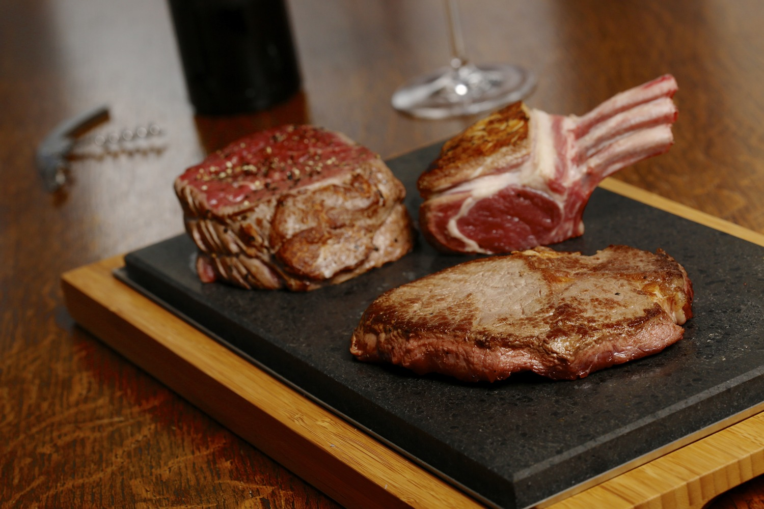 Fillet, Lamb & RibEye on the SteakStones Sharing Steak Plate Close
